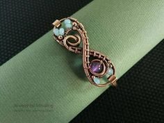 Amethyst & aquamarine infinity copper bracelet - Wire wrapped endless bangle - February birthstone - 7th anniversary gift for wife This bracelet is made from copper, amethyst and aquamarine gems. It is very light and comfortable. Bracelet has a clasp. Amethyst is a birthstone for