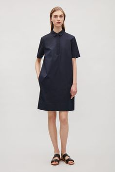 Made from stretch cotton with a soft satin finish, this dress has contrasting grosgrain trims along the button placket and collar. A straight fit, it is completed with a partial button fastening, neat short sleeves and hidden side pockets.