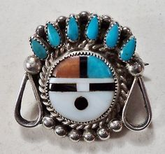 zuni sun face pin | Found on ebay.com