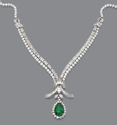 EMERALD AND DIAMOND PENDANT-NECKLACE.  The necklace designed as strands of ribbon joined in the center to form a circular knot, set with 135 round & single-cut diamonds & 115 baguette & tapered baguette diamonds, the center accented with a single marquise-shaped diamond  supporting a pendant set with a pear-shaped emerald framed by 22 round & marquise-shaped diamonds mounted in platinum, length 17 inches, pendant detachable.