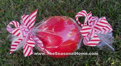 make outdoor Christmas candy. Roll a ball in cellophane wrap, tie with ribbon. Candy Land Christmas, Candy Christmas Decorations, Christmas Yard, Christmas Gingerbread, Noel Christmas, Christmas Projects, Christmas Themes, All Things Christmas, Christmas Bulbs