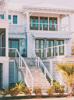 Transitional exterior with some more modern detailing (metal roof, colorful doors, cable deck railing) but still relating to historic Funzone elements