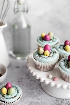 Milk and Honey Easter Cupcakes - Ella Nurse - Spring Recipe Easter Cupcakes, Mini Cupcakes, Easy Desserts, Dessert Recipes, Pistachio Cheesecake, Easter Dishes, Easter Egg Designs, Blue Food Coloring, Chocolate Squares