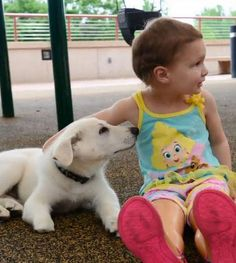 A 3-year-old girl without feet shares a special bond with the puppy she just adopted, who happened to be born without a paw.
