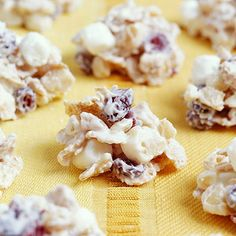 Melted white candy coating holds  puffy marshmallows, crunchy cereal, rich macadamia nuts and dried cranberries together in this quick and easy no-bake drop cookie. Store leftover macadamia nuts in the refrigerator; the rich nuts become rancid quickly when stored at room temperature.