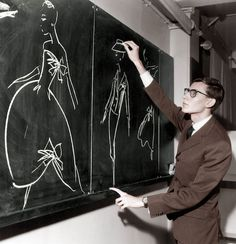 A young Yves Saint Laurent sketching some broad strokes...