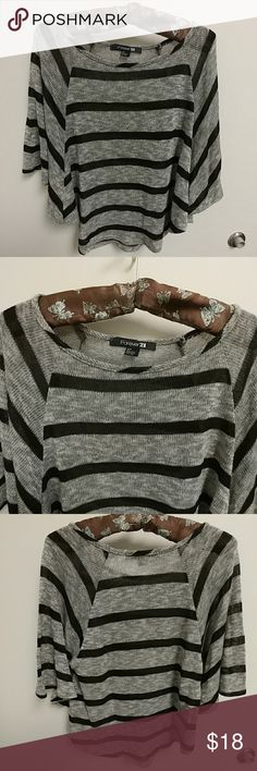 F21 Forever 21 striped batwing cropped sweater Heathered gray and black striped sweater from Forever 21. Features batwing style sleeves and is cropped (falls just above natural waist.) In excellent used condition (no rips, snags, or stains.) Forever 21 Sweaters Crew & Scoop Necks