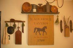 Black Horse Tavern sign and shelf above made of reclaimed barnwood