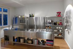 Stainless steel kitchen counter 320 cm wide, with three functional columns.