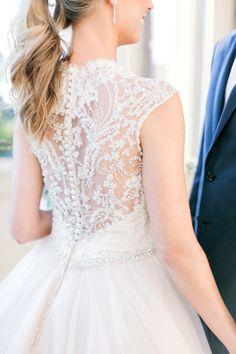 Gorgeous beaded back wedding dress: http://www.stylemepretty.com/oklahoma-weddings/2016/02/03/colorful-preppy-museum-wedding-in-oklahoma/ | Photography: Aubrey Marie - http://www.aubreymariephoto.com/