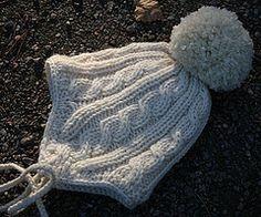 Ravelry: Halla - child's cabled hat pattern by Jonna Kolari