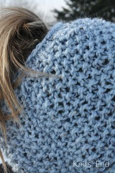 Seed Stitch Messy Bun Hat Knitting Pattern available for free. Beginner friendly that works up quick with stunning results