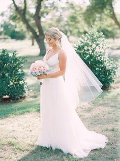 Classic bridal beauty: http://www.stylemepretty.com/texas-weddings/2016/04/14/a-gorgeous-blush-texas-wedding-on-a-tight-budget/   Photography: Tracy Enoch - http://www.tracyenoch.com/