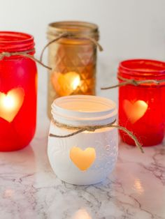 With a little spray paint, you can transform plain jars into beautiful Mason jar votive holders! Perfect for your Valentine's Day decor! Nutella Jar, Diy And Crafts, Crafts For Kids, Fun Crafts, Christmas Jam, Votive Holder, Painted Mason Jars, Dog Treat Recipes, Living At Home