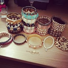 sort of what the shelf looks like in my room - bracelets stacked all over the place