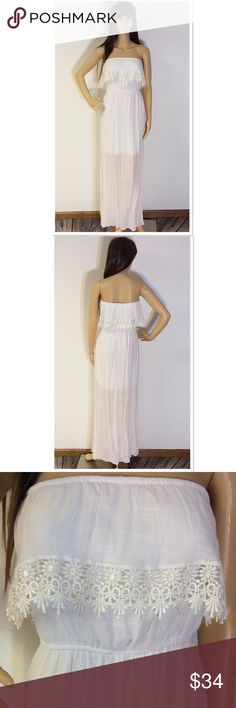"TRIXXI WHITE STRAPLESS MAXI DRESS Beautiful dress with lace trim. Banded at the top and waist for stretch. Slip hits about mid thigh and then SHEER to the bottom.  Lying flat Armpit to armpit 14"" waist 12.5"" length 50"" Trixxi Dresses Strapless"