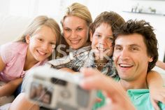 Family taking self portrait Royalty Free Stock Photo With coupon codes and promotional codes.