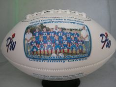 Regulation size Football with two white printable panels. Full color allows one to have up to two personal team/individual photos, favorite