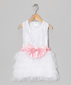 Fit for a giggling little glamour girl, this frilly frock touts a sequined bodice, a fluffy skirt and inner lining, so it's always soft, never itchy. A big, bright bow finishes off this glitzy gem of a dress.100%nylon tulleHand wash; dry flatImported