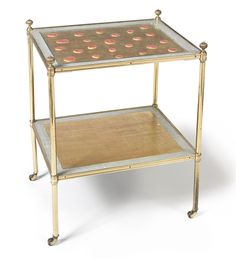 A parcel-gilt and intaglio-mounted brass two-tier low table