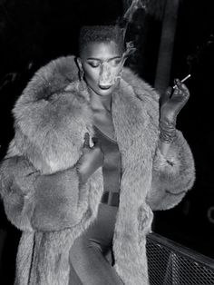 margotmeanie:  I wanna have a fashion moment like this. Except faux fur and no tobacco.