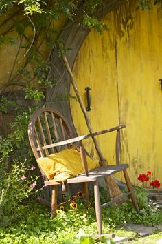 Wow. Amazing round yellow door. Great place to sit in the garden.