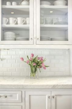 Beveled subway tile backsplash, white cabinets (would choose a darker counter top though)