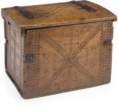An Alpine Gothic style iron bound carved pine covered box 18th century