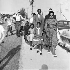Three African-American first grade students, accompanied by adults, and followed by white students and members of the press, walk toward Thomas Edison Elementary school in Dallas, Texas on Sept. 6, 1961, as integration of eight previously all-white schools commenced. Eighteen African-American students entered the schools without incident.