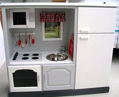 I'm obsessed with Tv cabinets turned play kitchens. (Probably because I loved my kitchen set as a kid.)