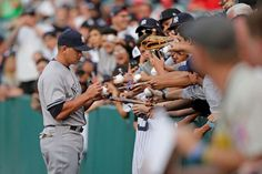 Fan favorite -        New York Yankees' Alex Rodriguez signs his autographs for the fans before of a baseball game against the Los Angeles Angels on June 30 in Anaheim, Calif.  -    © Jae C. Hong/AP Photo