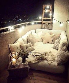 Whimsical outdoor retreat Oversized patio balcony chair with cafe lights.