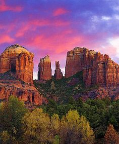 The red hills of Sedona, Arizona against pink and purple sky