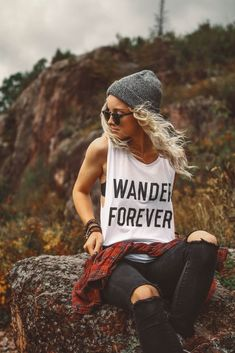 Wander Forever with our super soft and versatile white muscle tank. Also seen on Tory is our Mountain Necklace. Tory and Hailey are wearing size small. Size questions? See size chart.