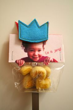 for treat bags...card with child's picture printed on it- text: CHILD OF THE KING- sew felt crown with magnet on back- glue washer to back of card so crown will stay in place