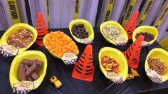 Construction hats filled with party food and construction signs from a Construction Party Printables via Mandy's Party Printables