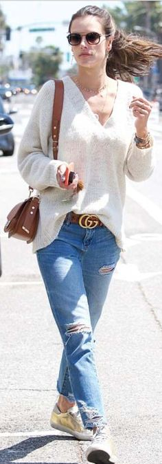 Who made Alessandra Ambrosio's brown belt, gold sneakers, and jewelry?
