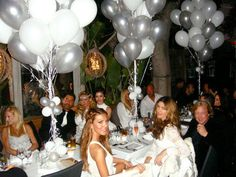 White party with silver accent. Great balloon arrangements.