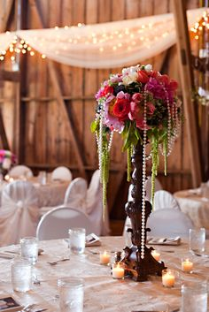 Make a statement with a bold floral centerpiece! #wedding #centerpiece #barn