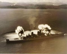 Battleship New Jersey firing a nine-gun salvo during bombardment operations against communist targets in Korea adjacent to the 38th parallel 10 November 1951.