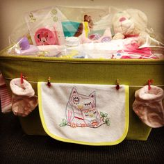 Baby shower basket, with hand embroidered bib (owl pattern from Sublime Stitching)