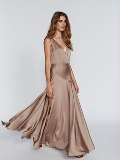 Essie Maxi Dress | Be a showstopper in this gorgeous and elegant matte satin gown featured in an empire silhouette.    * Crisscross neckline   * Open back   * Floor length skirt and a dramatic train   * Statement making thigh-high slit   * Hidden side zip   * Lined