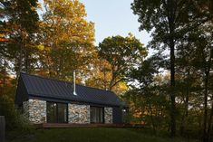 Perched atop a mountain on over six acres of woods, a young couple's weekend getaway incorporates the old with the new.