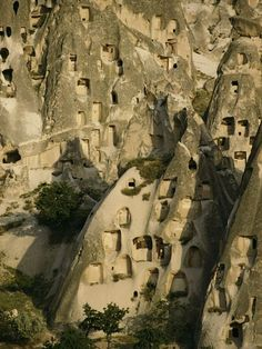 Photograph by Klaus Nigge  Cavelike dwellings built into soft rock dot the Cappadocia region of Turkey.