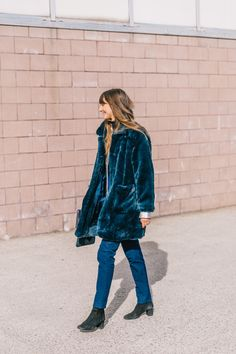 Lady in ('furry' and denim) blue
