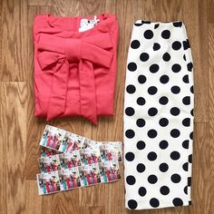 Our Signature Bow Top in Coral + Dainty Jewell's Pencil Skirt in black-and-white polka-dot = the perfect color combo!