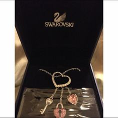 Perfect Christmas giftSwarovski heart necklace Beautiful Swarovski heart necklace with three charms from the heart - a key, a pink heart with key hole, and a pink heart. New in box✨ Swarovski Accessories