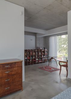 Image 5 of 20 from gallery of O House / SYAA. Photograph by Cosmin Dragomir Urban Apartment, Interior Design, Architecture, Building, Interiors, Book Shelves, Furniture, Concrete, Rug