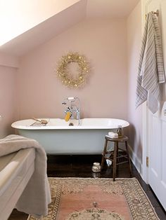 Love this gray-green claw-foot tub.