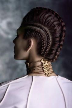 Braids are beautiful and says a lot about a women, professional stylists from around the world love to incorporate different braided trends and styles when creating runway looks. The stylist behind this hairdo seems to have influenced himself heavily from some medieval hairstyles while creating this beautiful avant-garde masterpiece.